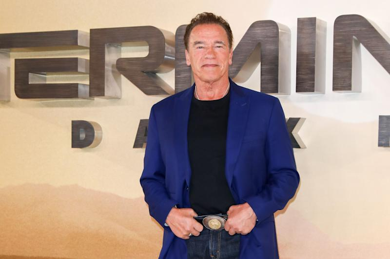 72-year-old Arnold Schwarzenegger is not aging as he stuns in a blue suit-jacket with black inner wear and pant to match