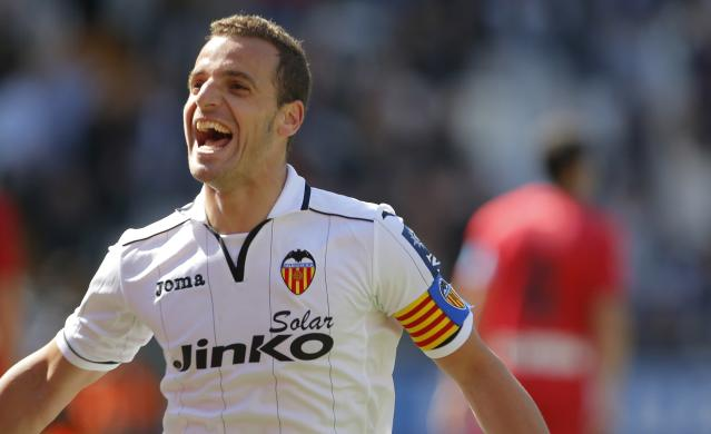 Valencia's forward Roberto Soldado celebrates after scoring during the Spanish league football match Valencia CF vs Club Atletico Osasuna at the Mestalla stadium in Valencia on May 4, 2013. AFP PHOTO/ JOSE JORDANJOSE JORDAN/AFP/Getty Images