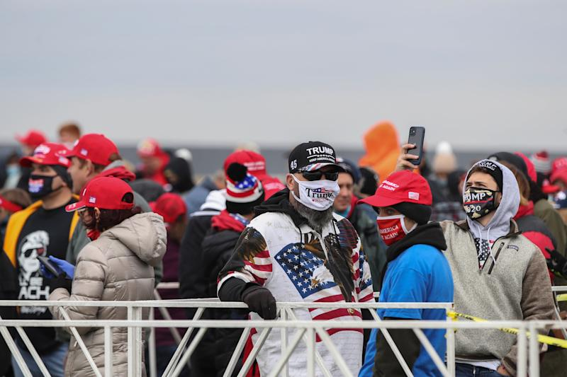 Supporters of Donald Trump wait in line to participate in his campaign rally at the Southern Wisconsin Regional Airport in Janesville, Wisconsin on 17 October 2020. (EPA)
