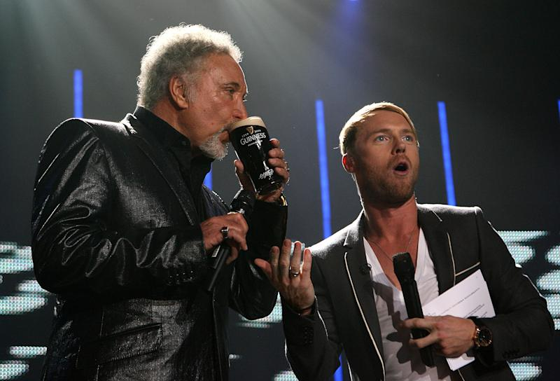 Ronan Keating (right) on stage with Tom Jones (left) at the 250th Anniversary of Guinness Concert, at the Storehouse, St James Gate Brewery, Dublin (Photo by Niall Carson/PA Images via Getty Images)