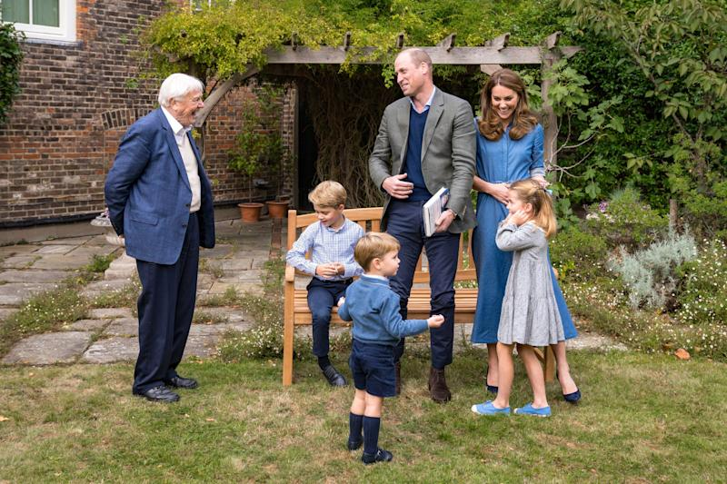 Prince William and Duchess Kate of Cambridge with Prince George, Prince Louis and Princess Charlotte and nature filmmaker David Attenborough in Kensington Palace gardens after viewing his latest film.