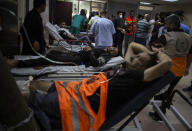 Palestinians receive treatment at the Shifa Hospital from their wounds caused by an Israeli airstrike that destroyed the upper floors of a commercial building and caused damage to the nearby Health Ministry and prime health care clinic, in Gaza City, Monday, May 17, 2021. (AP Photo/Khalil Hamra)