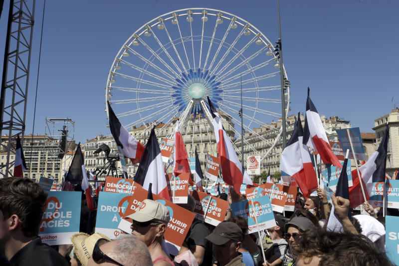 Supporters of French hard-left presidential candidate, Jean-Luc Melenchon, arrive to a attend a campaign rally in Marseille's Old Port, southern France, Sunday, April 9, 2017. The two-round presidential election is set for April 23 and May 7. (AP Photo/Claude Paris)