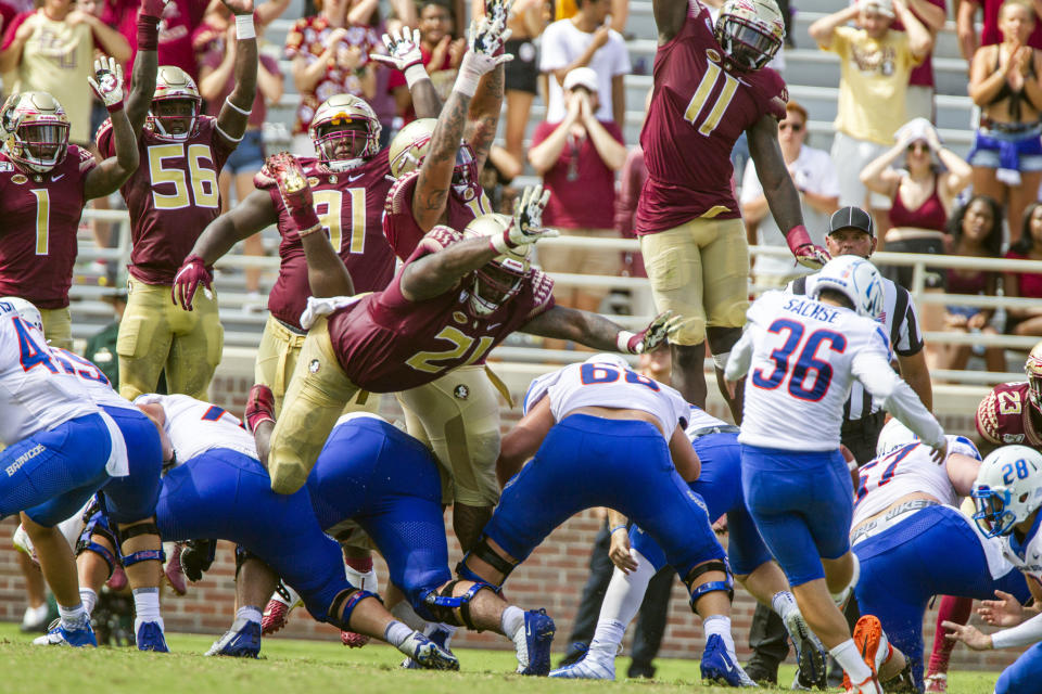 Florida State defense tries to block a field goal by Boise State place kicker Eric Sachse, right, in second the half of an NCAA college football game in Tallahassee, Fla., Saturday, Aug. 31, 2019. Boise State defeated Florida State 36-31. (AP Photo/Mark Wallheiser)