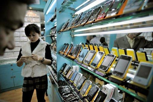 Fake iPhones are displayed in a shop at a market known for counterfeit goods in Shanghai