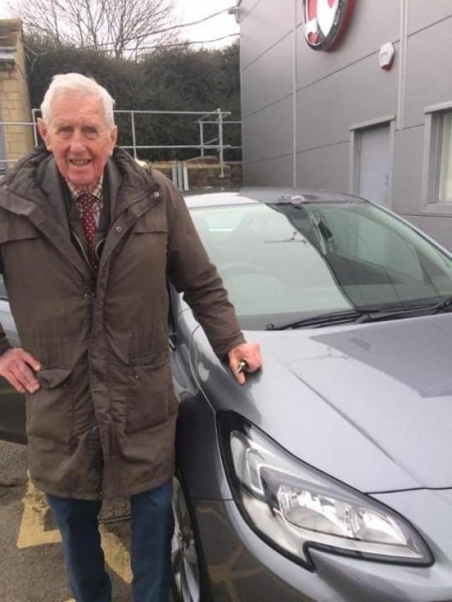 Peter Maddox with his new gray Vauxhall car
