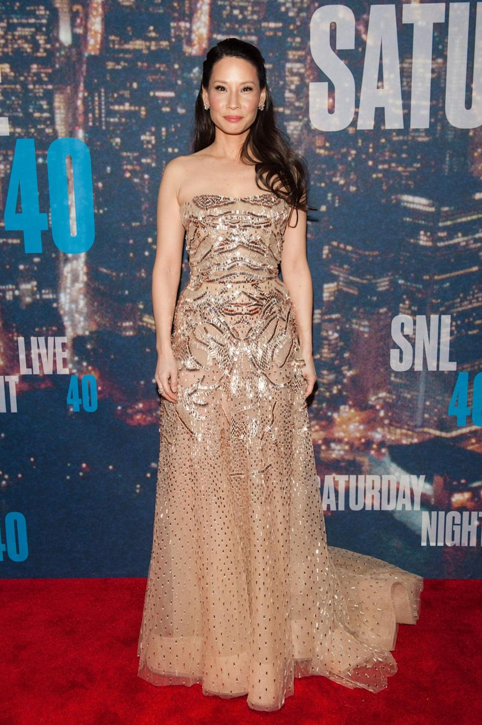 Escorting her Ally McBeal co-star to the anniversary show, Lucy Liu wore a nude sequin gown.