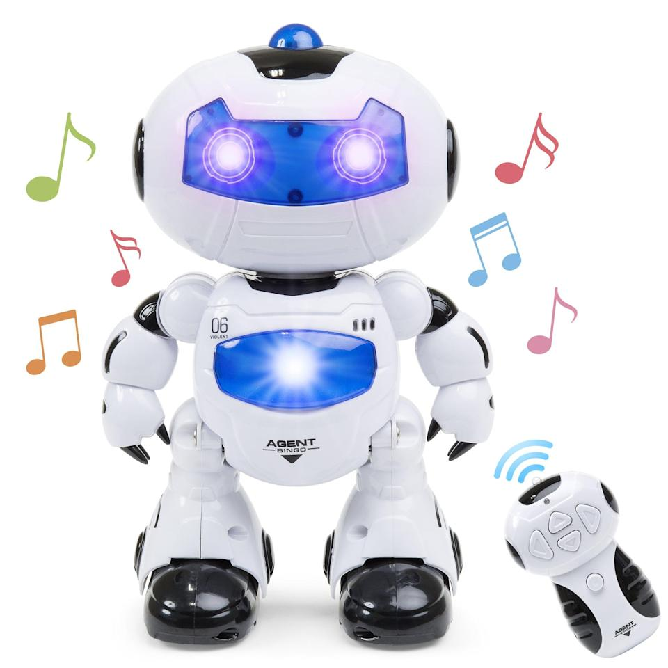 """<p>Fitted with lights and fun colors, this <a href=""""https://www.popsugar.com/buy/Intelligent-Walking-Dancing-Futuristic-Robot-388125?p_name=Intelligent%20Walking%20Dancing%20Futuristic%20Robot&retailer=walmart.com&pid=388125&price=26&evar1=moms%3Aus&evar9=25997679&evar98=https%3A%2F%2Fwww.popsugar.com%2Fphoto-gallery%2F25997679%2Fimage%2F45499359%2FIntelligent-Walking-Dancing-Futuristic-Robot-STEM-Toy-w-Music-Lights&list1=holiday%2Cgift%20guide%2Ckid%20shopping%2Choliday%20living%2Choliday%20for%20kids&prop13=api&pdata=1"""" class=""""link rapid-noclick-resp"""" rel=""""nofollow noopener"""" target=""""_blank"""" data-ylk=""""slk:Intelligent Walking Dancing Futuristic Robot"""">Intelligent Walking Dancing Futuristic Robot </a> ($26) gets them dancing and singing along to their favorite songs.</p>"""