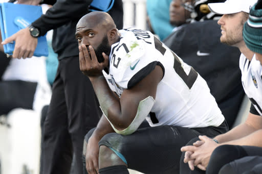 FILE - In this Nov. 24, 2019, file photo, Jacksonville Jaguars running back Leonard Fournette (27) sits on the bench in the first half of an NFL football game against the Tennessee Titans, in Nashville, Tenn. The Jacksonville Jaguars have waived running back Leonard Fournette, a stunning decision that gets the team closer to purging Tom Coughlin's tenure. (AP Photo/Mark Zaleski, File)