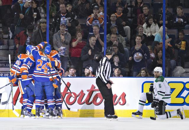 Dallas Stars' Trevor Daley (6) looks on as the Edmonton Oilers celebrate a goal during first period NHL hockey action in Edmonton, Alberta, on Sunday Dec. 21, 2014. (AP Photo/The Canadian Press, Jason Franson)