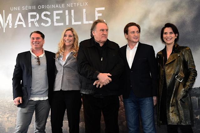 "From L: French director Florent Emilio-Siri and French actors Natacha Regnier, Gerard Depardieu, Benoit Magimel and Geraldine Pailhas promote the French TV show ""Marseille"" (AFP Photo/ANNE-CHRISTINE POUJOULAT)"