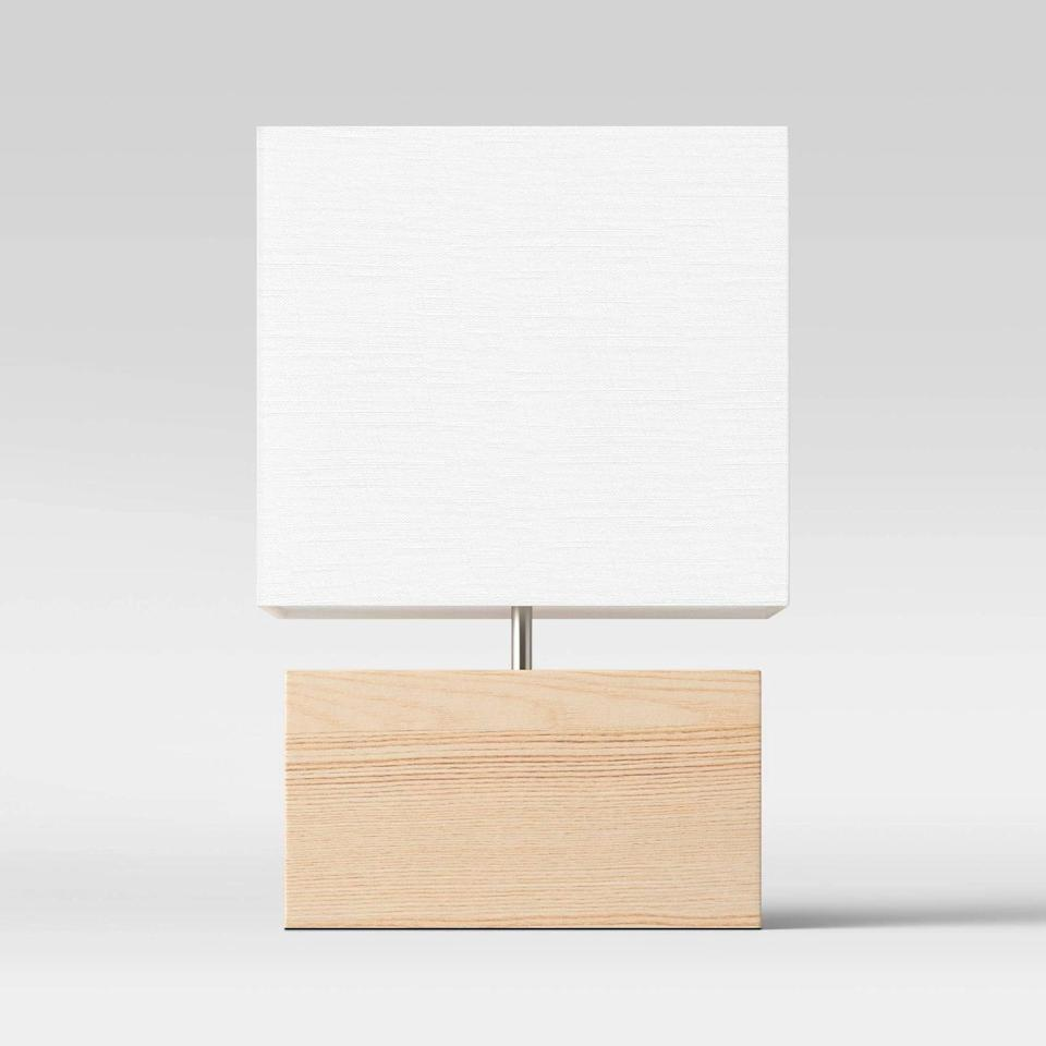 <p>The design of this <span>Project 62 Wood Block Table Lamp</span> ($35) is so cool. It would be a great addition to any side table.</p>