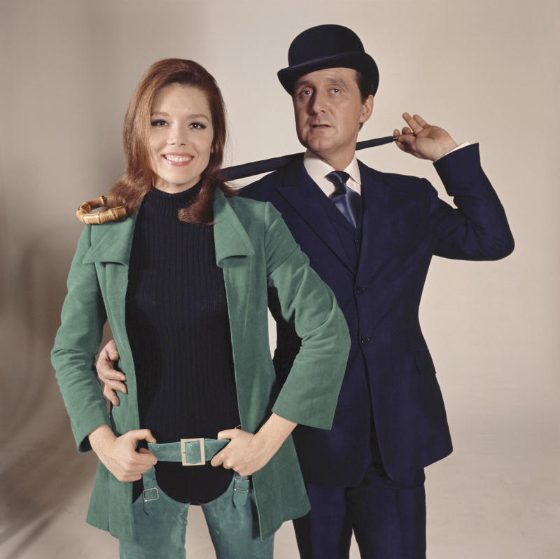 British actors Diana Rigg and Patrick Macnee are Emma Peel and John Steed, on the set of the TV Series The Avengers, created by Sydney Newman . (Photo by ABC Weekend Television/Associated British Corporation/Sunset Boulevard/Corbis via Getty Images)
