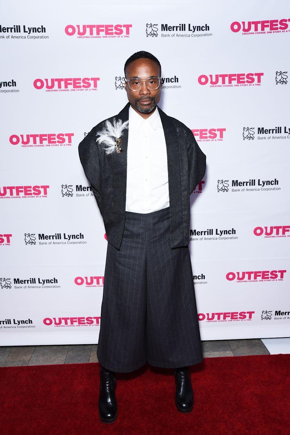 <p>Porter at the 13th annual Outfest Legacy Awards in a kimoni-style jacket, pinstripe culottes, and a feather brooch. </p>