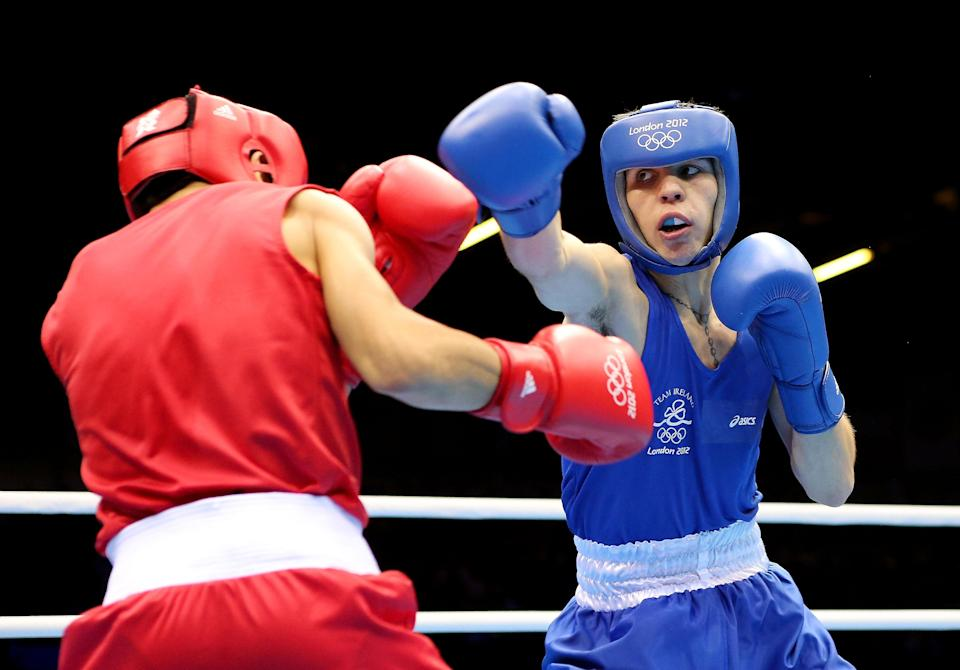 LONDON, ENGLAND - AUGUST 07: Michael Conlan of Ireland (R) in action with Nordine Oubaali of France during the Men's Fly (52kg) Boxing on Day 11 of the London 2012 Olympic Games at ExCeL on August 7, 2012 in London, England. (Photo by Scott Heavey/Getty Images)