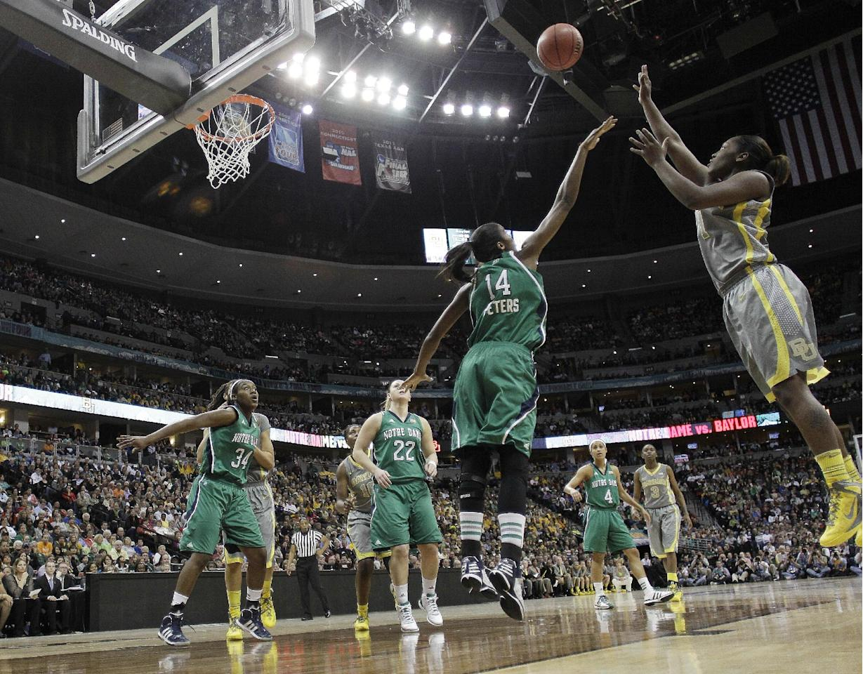 Baylor guard Kimetria Hayden (1) shoots over Notre Dame forward Devereaux Peters (14) during the first half in the NCAA women's Final Four college basketball championship game, in Denver, Tuesday, April 3, 2012. (AP Photo/Eric Gay)