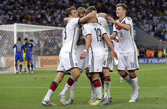 Germany's Mario Goetze, 19, is congratulated by his teammates after scoring the opening goal during the World Cup final soccer match between Germany and Argentina at the Maracana Stadium in Rio de Janeiro, Brazil, Sunday, July 13, 2014. Germany won 1-0 to win the World Cup. (AP Photo/Victor R. Caivano)