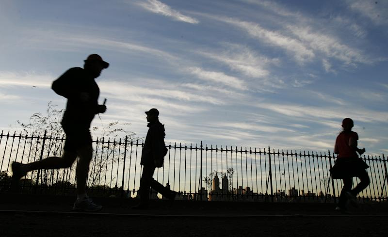 Runners take the jogging path around the Central Park reservoir, December 3, 2006, in New York