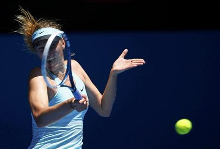 Maria Sharapova of Russia hits a return to Karin Knapp of Italy during their women's singles match at the Australian Open 2014 tennis tournament in Melbourne January 16, 2014. REUTERS/David Gray