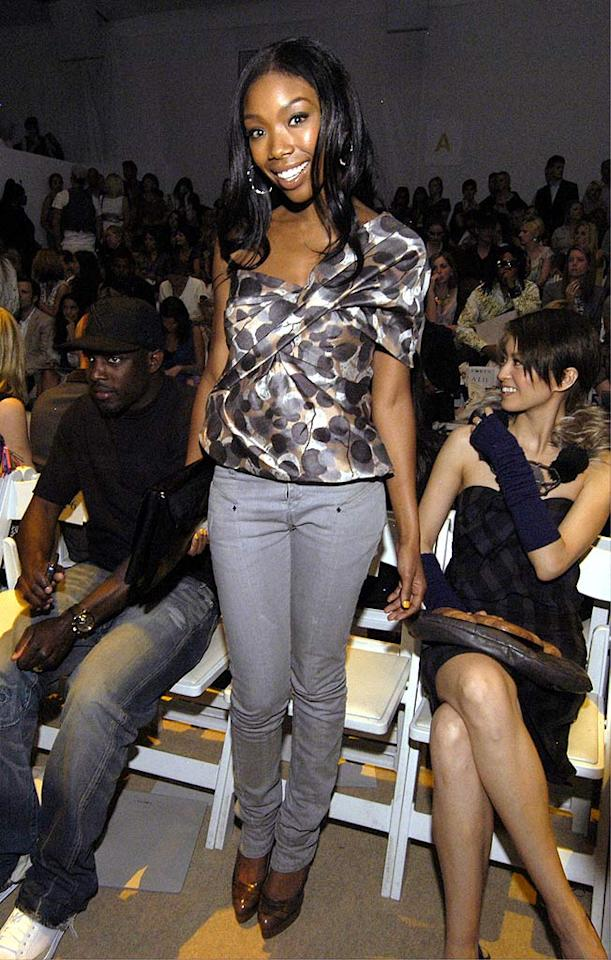 "Polka dots were also seen on Brandy's asymmetrical top. The singer paired it with some sexy skinny jeans at the Ports 1961 show. Paul Warner/<a href=""http://www.wireimage.com"" target=""new"">WireImage.com</a> - September 8, 2008"