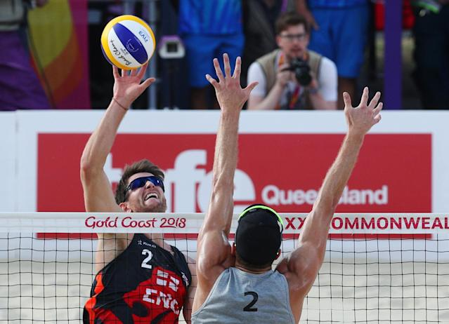 Beach Volleyball - Gold Coast 2018 Commonwealth Games - Men's Bronze Medal Match - England v New Zealand - Coolangatta Beachfront - Gold Coast, Australia - April 12, 2018. Jake Sheaf of England in action with Sam O'Dea of New Zealand. REUTERS/Athit Perawongmetha
