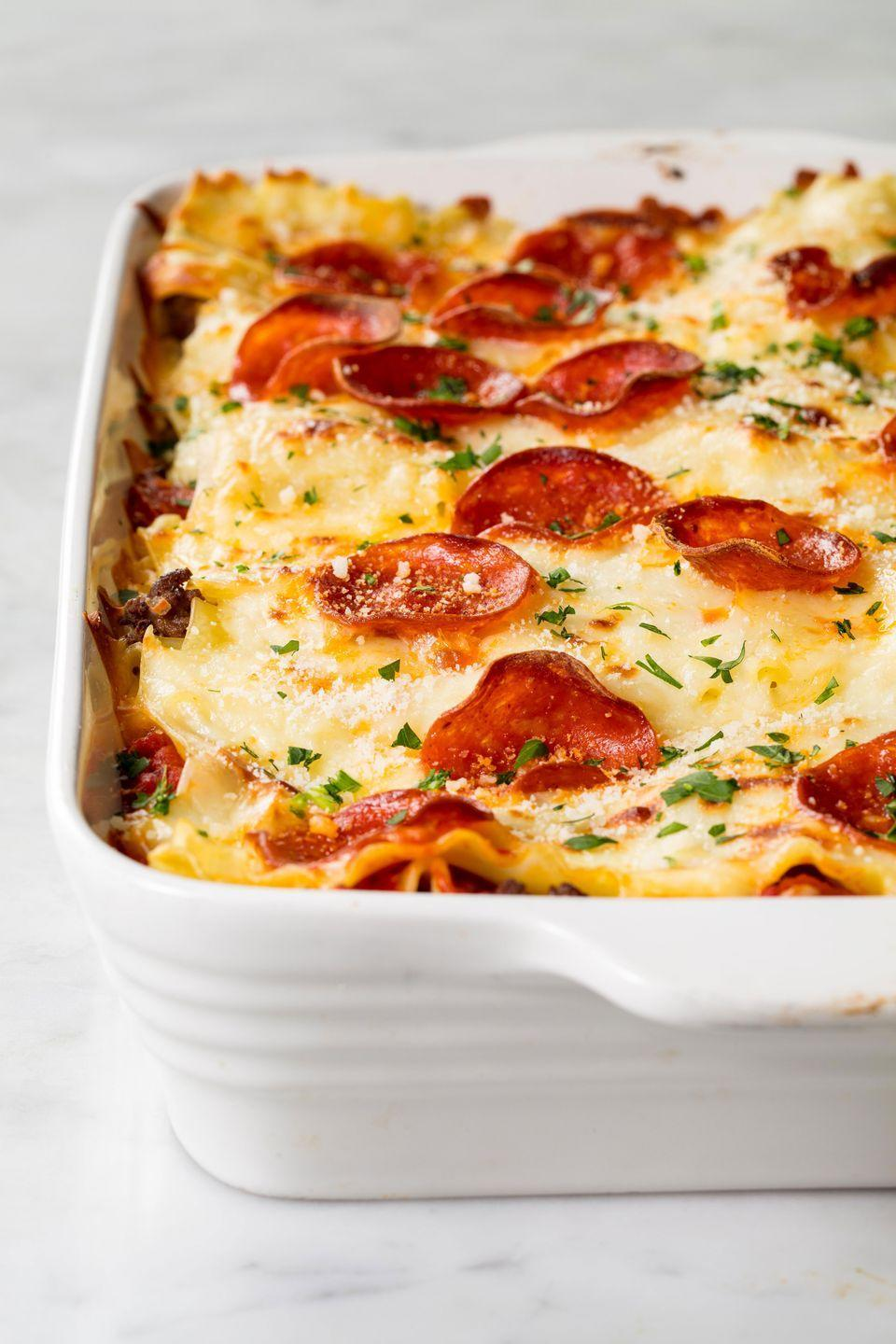 """<p>The food mashup to end them all.</p><p>Get the recipe from <a href=""""https://www.delish.com/cooking/recipe-ideas/recipes/a48503/pizzagna-recipe/"""" rel=""""nofollow noopener"""" target=""""_blank"""" data-ylk=""""slk:Delish"""" class=""""link rapid-noclick-resp"""">Delish</a>.</p>"""