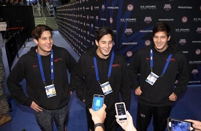 Jay Litherland (L), Kevin and Mick Litherland speak during the U.S. swim trials. (AP)