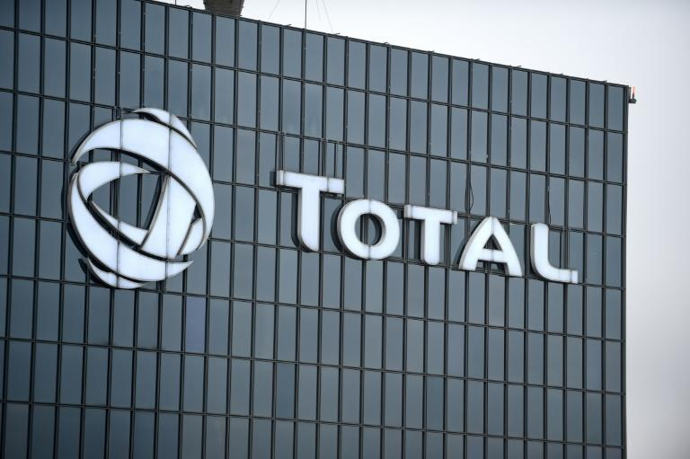 A picture taken on January 23, 2018 shows the logo of Total at the company's headquarters in La Defense business district in Paris