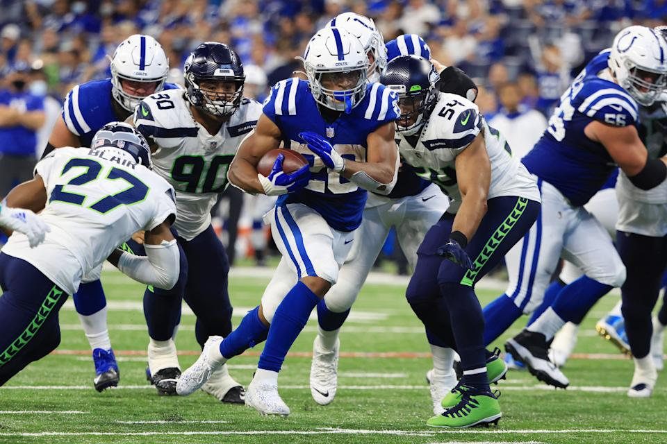 INDIANAPOLIS, INDIANA - SEPTEMBER 12: Jonathan Taylor #28 of the Indianapolis Colts runs the ball during the fourth quarter against the Seattle Seahawks at Lucas Oil Stadium on September 12, 2021 in Indianapolis, Indiana. (Photo by Justin Casterline/Getty Images)