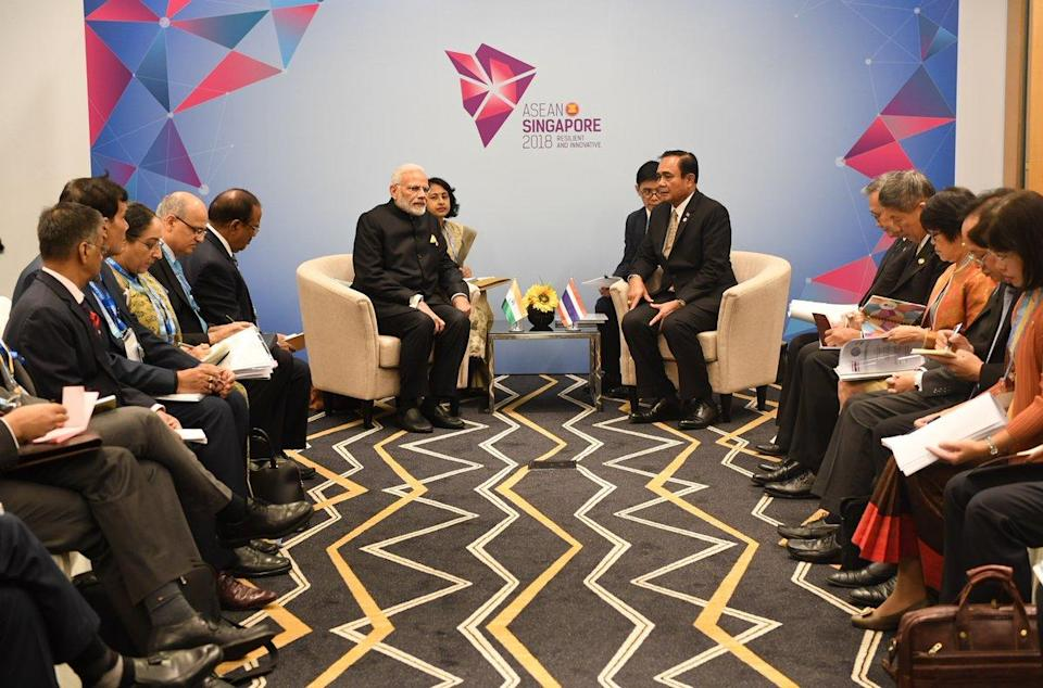 PM Modi interacting with Thai PM, Prayut Chan-o-cha on the sidelines ASEAN meet.