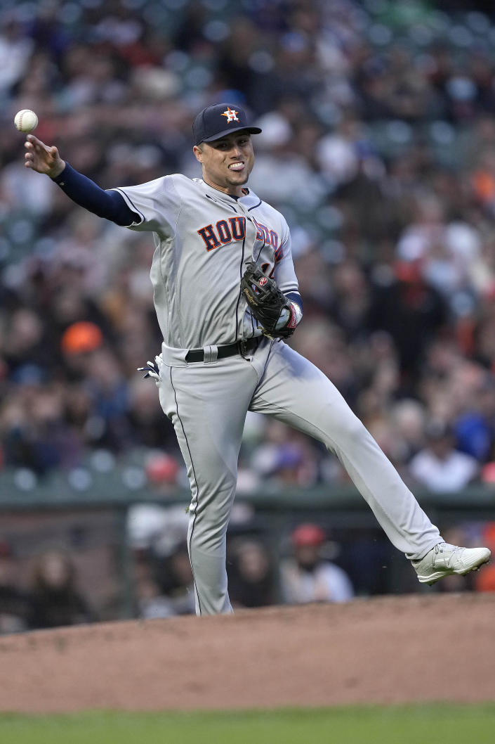 Houston Astros second baseman Aledmys Diaz throws to first base for the out on a ball hit by San Francisco Giants' Donovan Solano during the third inning of a baseball game Friday, July 30, 2021, in San Francisco. (AP Photo/Tony Avelar)