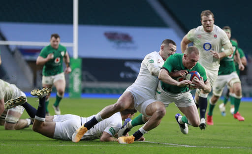 England's Jonny May tackles Ireland's Keith Earls during the Autumn Nations Cup rugby union international match between England and Ireland at Twickenham stadium in London, Saturday, Nov. 21, 2020. (AP Photo/Ian Walton)
