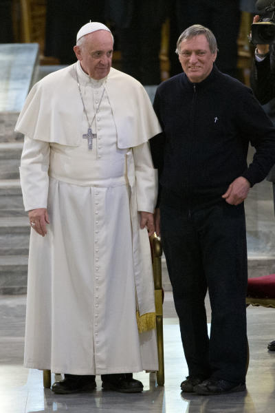 Pope Francis and Don Luigi Ciotti attend a meeting with relatives of innocent mafia victims, in Rome's St. Gregorio VII church, just outside the Vatican, Friday, March 21, 2014. (AP Photo/Andrew Medichini)