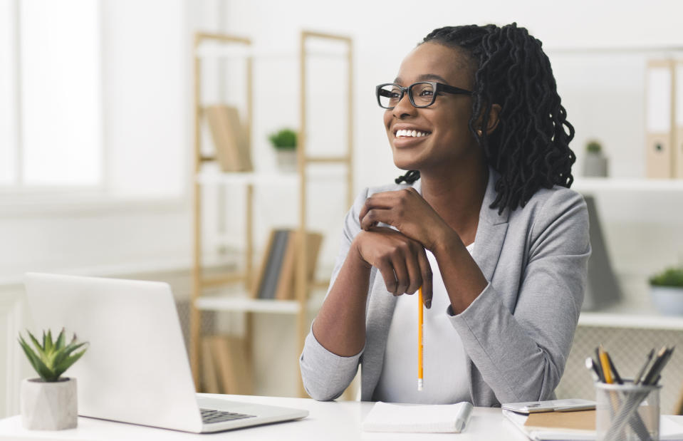 Business Career Concept. Afro Businesswoman Smiling Sitting In Modern Office. Copy Space