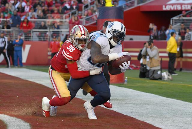 <p>Delanie Walker #82 of the Tennessee Titans catches a touchdown pass over Adrian Colbert #38 of the San Francisco 49ers during their NFL football game at Levi's Stadium on December 17, 2017 in Santa Clara, California. (Photo by Thearon W. Henderson/Getty Images) </p>