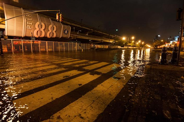 This photo provided by Dylan Patrick shows flooding along the Westside Highway as Sandy moves through the area Monday, Oct. 29, 2012 in New York. Much of New York was plunged into darkness Monday by a superstorm that overflowed the city's historic waterfront, flooded the financial district and subway tunnels and cut power to nearly a million people. (AP Photo/Dylan Patrick) MANDATORY CREDIT: DYLAN PATRICK