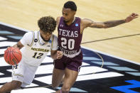 Michigan's Mike Smith (12) drives against Texas Southern's Michael Weathers (20) during the second half of a first-round game in the NCAA men's college basketball tournament, Saturday, March 20, 2021, at Mackey Arena in West Lafayette, Ind. (AP Photo/Robert Franklin)