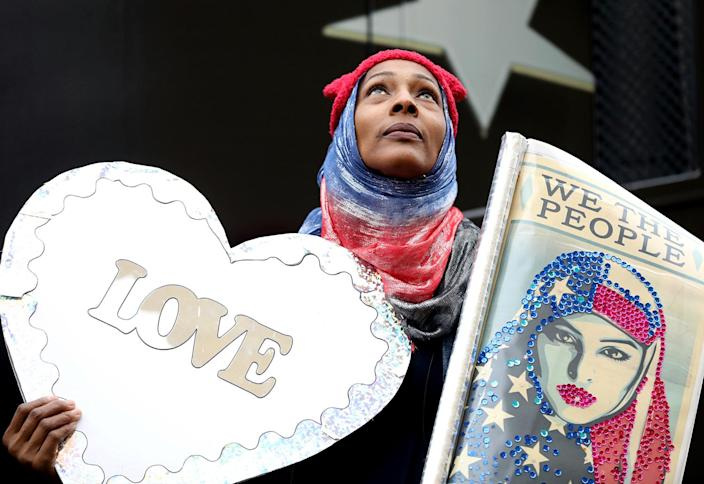 <p>Zee Arenas, of Maryland, stood for hours on a post above the crowd holding signs at the Women's March in Washington in Washington D.C., on Saturday, Jan. 21, 2017. (Renee Jones Schneider /Star Tribune via AP) </p>