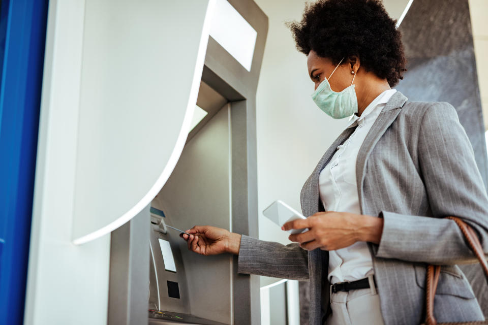 Americans are paying record-high fees for checking accounts, while receiving historically low returns, according to a new survey. (Photo: Getty)