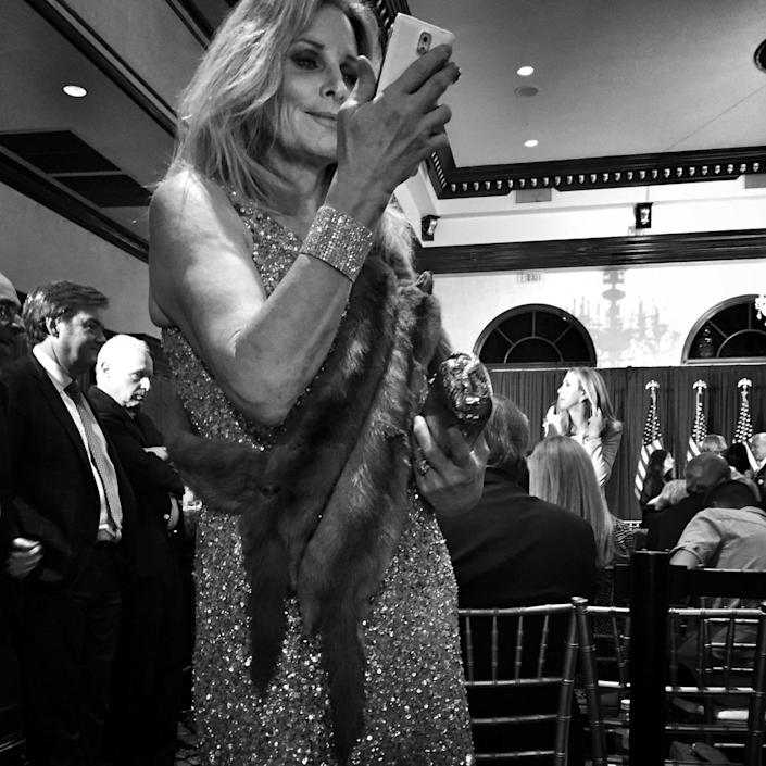 <p>A Trump supporter in a mink stole awaits the candidate at a campaign event on March 5 in West Palm Beach, Fla. (Photo: Holly Bailey/Yahoo News) </p>