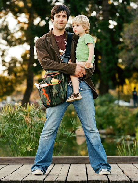 This 2006 image provided by DiaperDude.com shows Chris Pegula and his son Cole, then 3, in Santa Monica, Calif., with a DiaperDude diaper bag. The bag is one of dozens of styles from the company, which sells diaper bags designed to appeal to men. Pegula created the company and its product line because he felt his wife's diaper bags were too feminine. (AP Photo/DiaperDude.com, Debra McClinton)