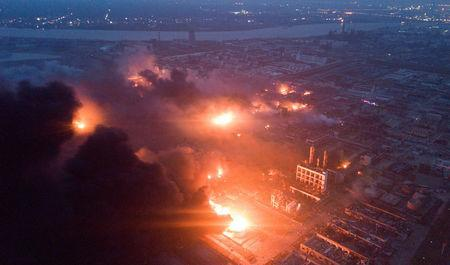 Smoke billows from fire following an explosion at the pesticide plant owned by Tianjiayi Chemical, in Xiangshui county, Yancheng, Jiangsu province, China March 21, 2019. REUTERS/Stringer