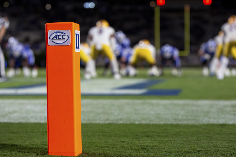 The ACC and Duke logos seen on a pylon at the back of and end zone during an NCAA college football game between Duke and Pittsburgh in Durham, N.C., Saturday, Oct. 5, 2019. (AP Photo/Ben McKeown)
