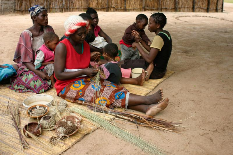 Local women making handicraft goods to be sold in the Mashi Craft center of the Mayuni Conservancy.  The selling of the goods is a valuable source of income for the villages of the conservancy. Choi village, Mayuni Conservancy, East Caprivi, Namibia. © WWF-Cannon/Folke Wulf