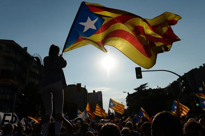 Wealthy Catalonia, which represents around 20 percent of Spain's economic output, regularly complains that much of the tax money it sends to Madrid is used to prop up poorer regions (AFP Photo/JOSEP LAGO)