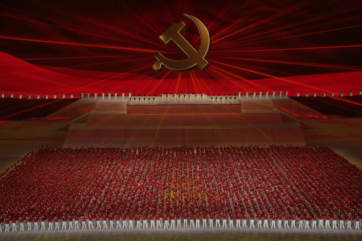 Performers line up , in front of the Communist Party emblem at a gala show ahead of the 100th anniversary of the founding of the Chinese Communist Party in Beijing on Monday, June 28, 2021. China is marking the centenary of its ruling Communist Party this week by heralding what it says is its growing influence abroad, along with success in battling corruption at home. (AP Photo/Ng Han Guan)