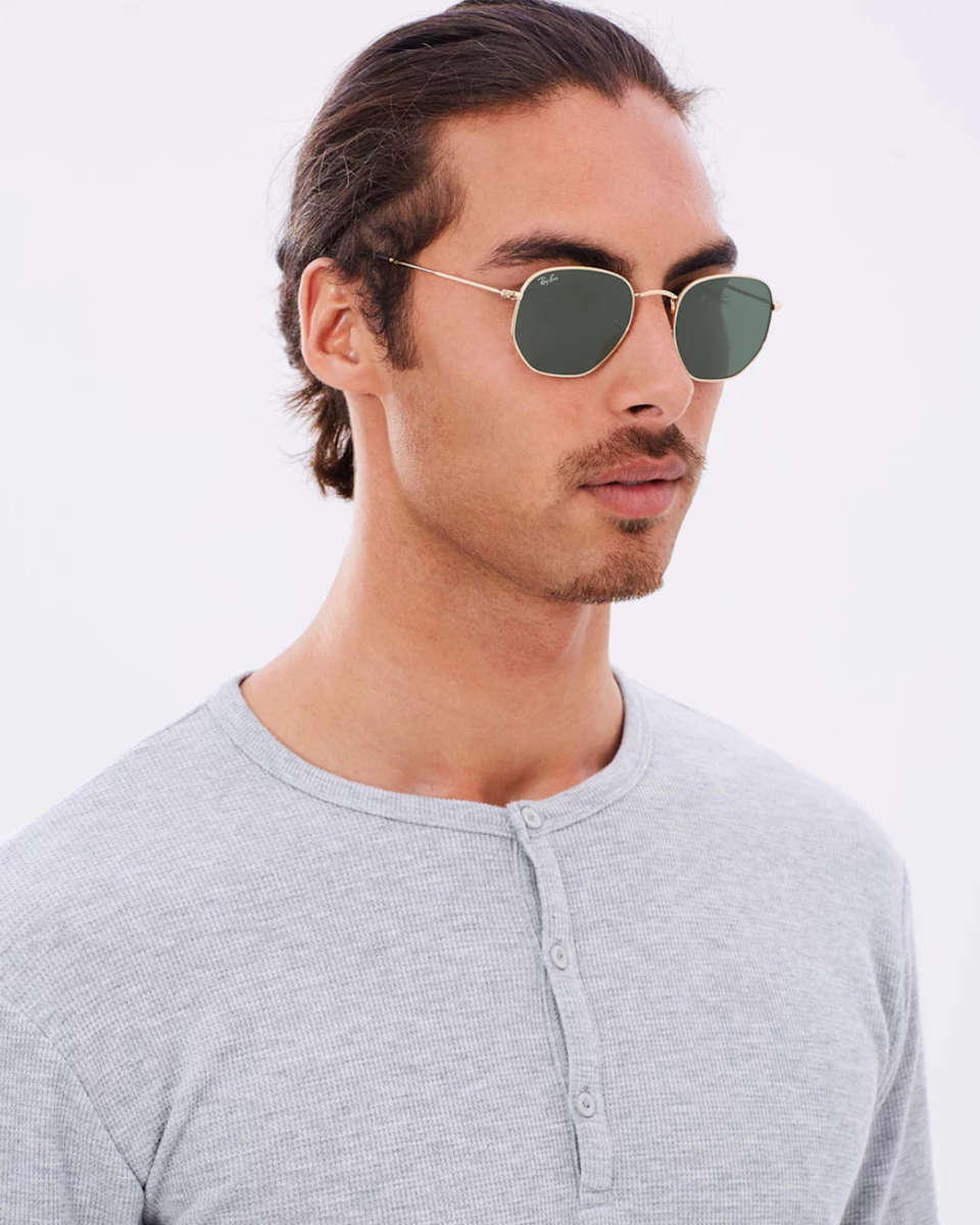 Man wears hexagonal Ray-Ban sunglasses from The Iconic