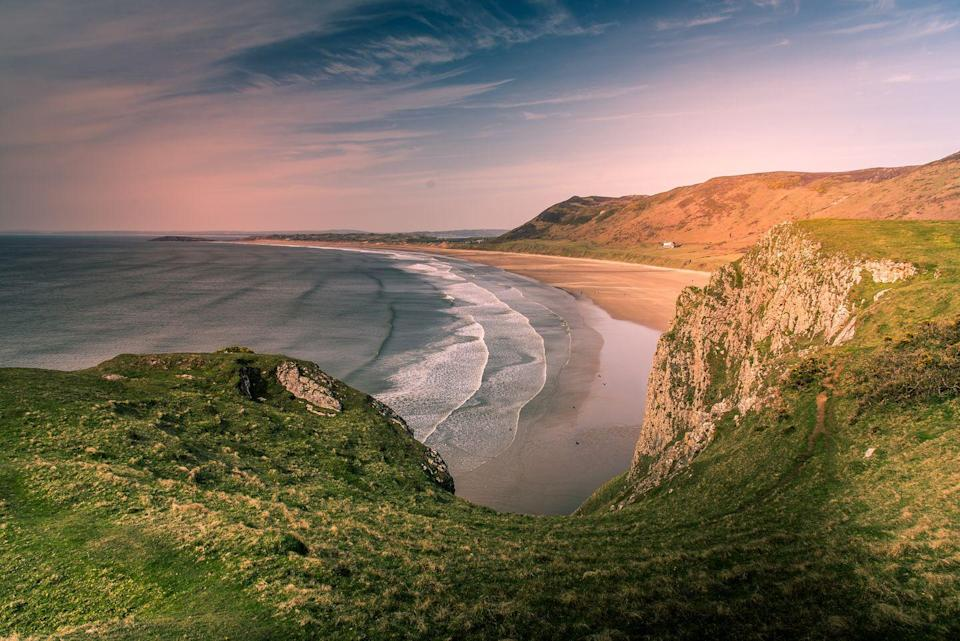 """<p><strong>At the time of writing, travel in Wales is limited to essential travel only. Please check the <a href=""""https://gov.wales/coronavirus-firebreak-frequently-asked-questions"""" rel=""""nofollow noopener"""" target=""""_blank"""" data-ylk=""""slk:latest advice from the Welsh government"""" class=""""link rapid-noclick-resp"""">latest advice from the Welsh government</a> before planning a trip.</strong></p><p>Often featuring high on many best beaches in the world lists, Rhossili Bay is certainly one of Britain's top winter beaches. Three miles of flour-fine beach sand encompass the famous Worms Head landmark. Rhossili Bay is part of the Gower Coast Path, so expect excellent routes with captivating views - and do bring the dog. And, if you're lucky you may even dolphins or basking seals enjoying the area too.</p><p><strong>Where to stay: </strong>The <a href=""""https://go.redirectingat.com?id=127X1599956&url=https%3A%2F%2Fwww.booking.com%2Fhotel%2Fgb%2Fbroad-park.en-gb.html%3Faid%3D2070935&sref=https%3A%2F%2Fwww.countryliving.com%2Fuk%2Ftravel-ideas%2Fstaycation-uk%2Fg34437103%2Fbritain-best-winter-beaches%2F"""" rel=""""nofollow noopener"""" target=""""_blank"""" data-ylk=""""slk:Broad Park B&B"""" class=""""link rapid-noclick-resp"""">Broad Park B&B</a> is set right near the beach and is a comfortable base for walkers.</p><p><a class=""""link rapid-noclick-resp"""" href=""""https://go.redirectingat.com?id=127X1599956&url=https%3A%2F%2Fwww.booking.com%2Fhotel%2Fgb%2Fbroad-park.en-gb.html%3Faid%3D2070935&sref=https%3A%2F%2Fwww.countryliving.com%2Fuk%2Ftravel-ideas%2Fstaycation-uk%2Fg34437103%2Fbritain-best-winter-beaches%2F"""" rel=""""nofollow noopener"""" target=""""_blank"""" data-ylk=""""slk:CHECK AVAILABILITY"""">CHECK AVAILABILITY</a></p>"""