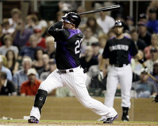 Colorado Rockies' Jason Giambi hits a two-run home run against the Texas Rangers during the second inning of a spring training baseball game, Friday, March 30, 2012, in Scottsdale, Ariz. (AP Photo/Marcio Jose Sanchez)