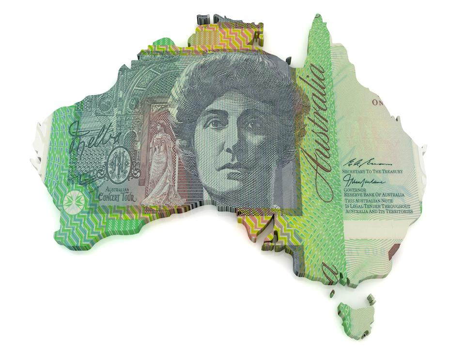 Pictured: Australian cash in shape of Australia, suggesting cost of living. Image: Getty